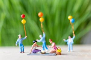 Miniature people, a beautiful couple of lesbian ladies having fun in the park with children photo