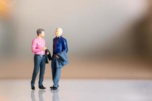 Miniature people, gay couple standing together and copy space for text, LGBT concept photo
