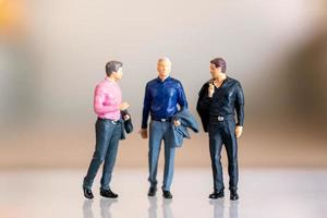 Miniature people, gay people standing together and copy space for text, LGBT concept photo
