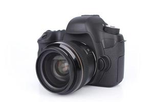 Retro black DSLR camera isolated on white background photo