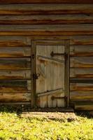 Wooden door in a wooden house photo