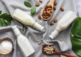 Assorted milks on a gray cloth photo