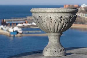 Decorative stone vase with a blurred marina in Vladivostok, Russia photo