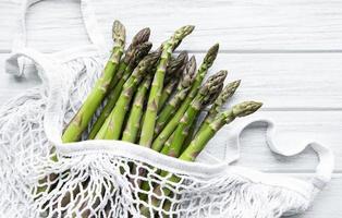 Asparagus stems in a white bag