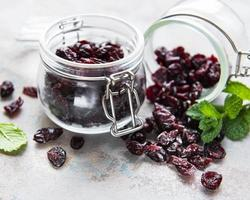 Jars of dried cherries photo