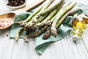 Bunch of raw asparagus stems with different spices