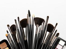 Set of makeup brushes on a white background photo