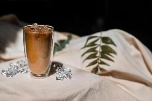 Close-up glass of iced coffee with milk on the table photo