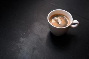 Black coffee morning on a black table photo
