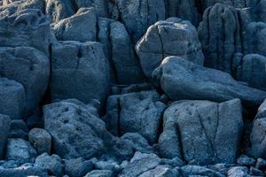 Wall of lava rock formations photo