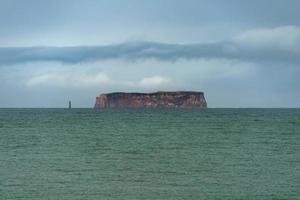 Drangey Island outside northern Iceland photo