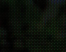 Abstract background pattern of colored blurry dots on a dark background close up photo