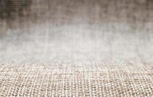 Blank background pattern of rough fabric matting in blur, macro close up photo