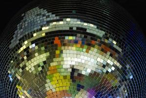Colorful disco ball on black background close up photo