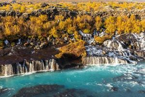Hraunfossar waterfall in Iceland in autumn colors