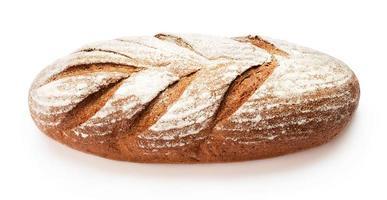 Single loaf of fresh baked bread isolated on white background photo