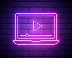 Glowing neon line Online play video icon isolated on brick wall background. Laptop and film strip with play sign. vector