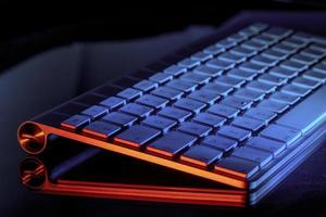 Keyboard illuminated in orange light photo