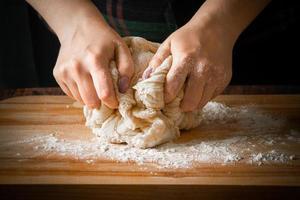 The chef prepares pizza dough photo
