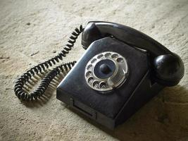 Vintage landline telephone with coiled cable photo
