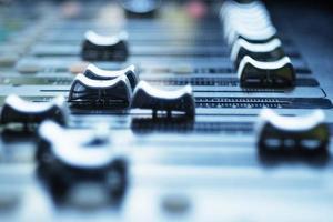Audio mixer control panel with sliders. photo