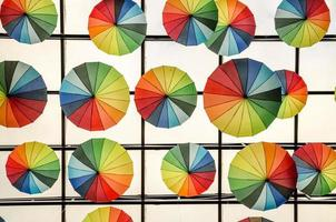 Colorful umbrellas hanging on the ceiling photo