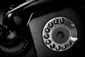 Vintage landline telephone in black and white photo