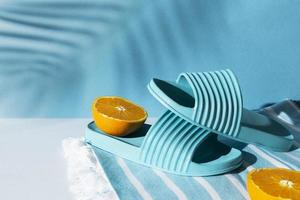 Arrangement with blue flip flops and orange photo