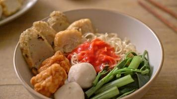 Egg Noodles with Fish Balls and Shrimp Balls in Pink Sauce. video