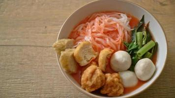 Small Flat Rice Noodles with Fish Balls and Shrimp Balls in Pink Soup video