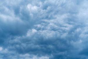 Beautiful blue cloudscape from storm clouds photo