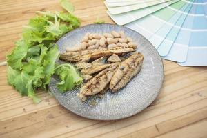 Grilled mackerel with paint color swatch photo