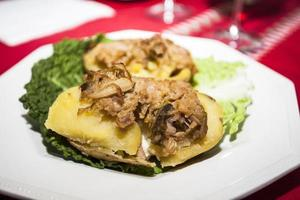 Potatoes stuffed with cabbage on a plate photo