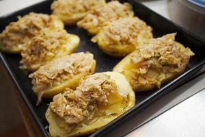 Potatoes stuffed with cabbage on a tray photo