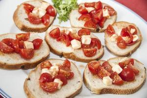 Tomato and cheese on bread photo