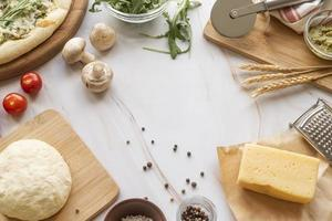 Pizza dough and ingredients with copy space photo