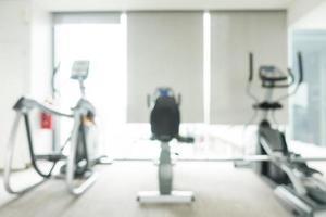 Defocused gym and fitness club interior photo