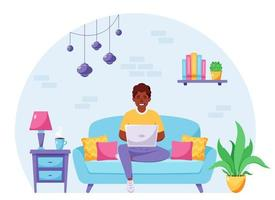 African american man sitting on a sofa and working on laptop. Freelancer, home office concept. Vector illustration