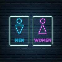 baño de hombres y mujeres letrero de neón vector