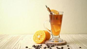 A Glass of Iced Americano Black Coffee and A Layer of Orange Decorated with Rosemary and Cinnamon video