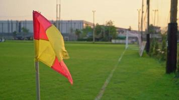 Corner Flag Swaying with The Wind on A Soccer Field