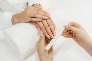 Healthy beautiful manicure and manicurist with file photo