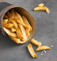 High angle french fries with salt photo