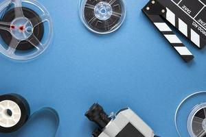 Arrangement of cinema elements on blue background with copy space photo