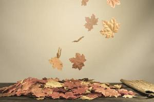 Autumnal foliage with spinning wind photo