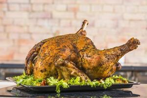 Baked turkey with lettuce on pan photo