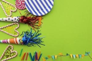 Birthday composition with blank space on green background photo
