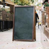 Blackboard near a cafe photo