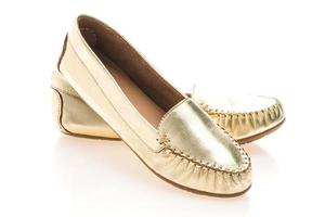zapatos de mujer dorados foto