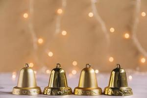 Christmas composition with small metallic bells photo